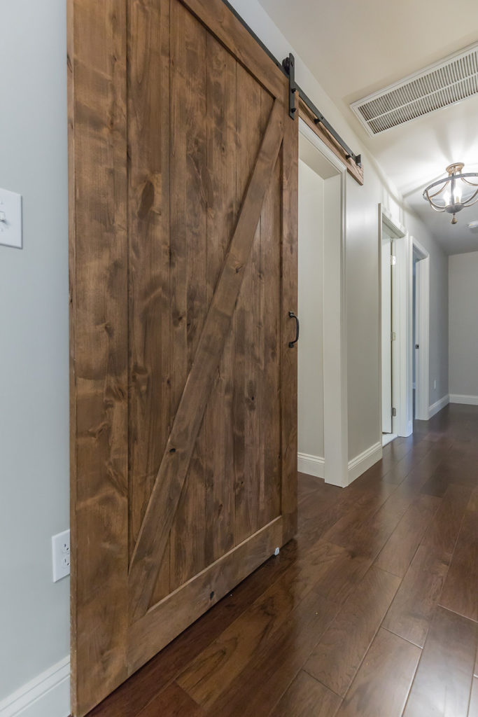 AFTER: And, Sliding Barn Door (stained) with Worldly Grey by Sherwin Williams on the Walls
