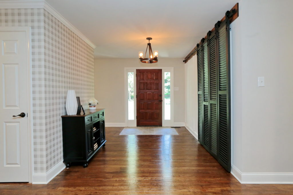 Front Entry with Herringbone Ceramic Tile & Vintage Shutter Louvre Doors