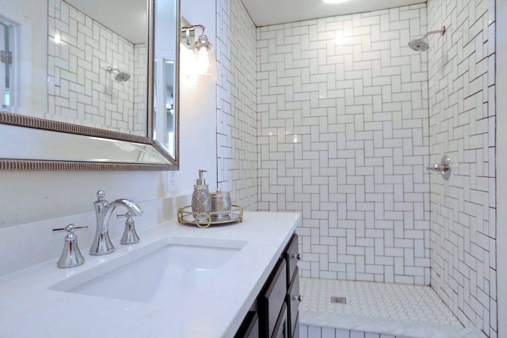 Master Walk In Shower with a Creative Twist on Subway Tile